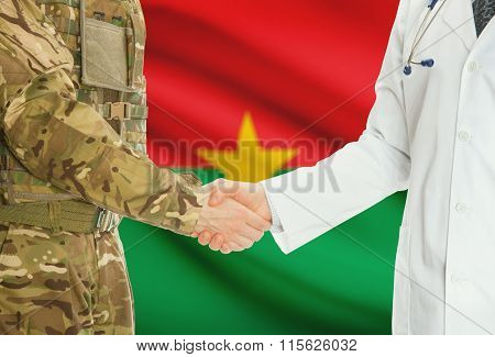 Military Man In Uniform And Doctor Shaking Hands With National Flag On Background - Burkina Faso