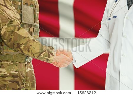 Military Man In Uniform And Doctor Shaking Hands With National Flag On Background - Denmark