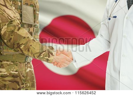 Military Man In Uniform And Doctor Shaking Hands With National Flag On Background - Greenland