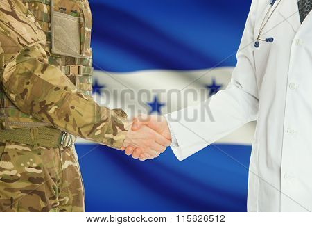 Military Man In Uniform And Doctor Shaking Hands With National Flag On Background - Honduras