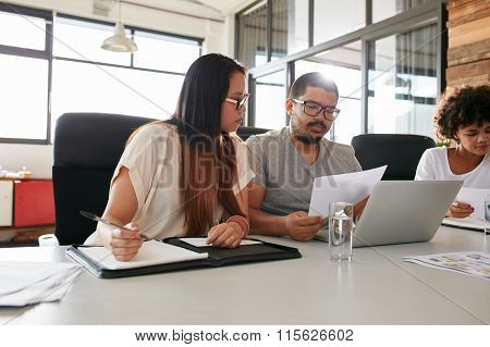 Businesspeople Having Meeting In A Office