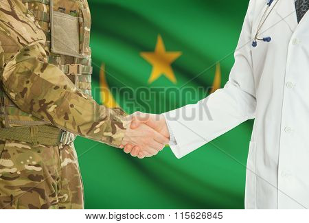 Military Man In Uniform And Doctor Shaking Hands With National Flag On Background - Mauritania