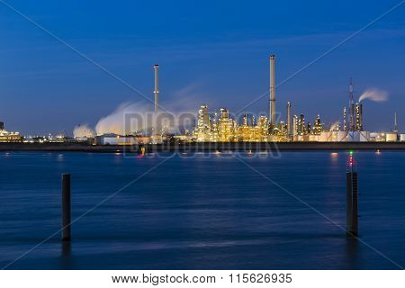 Chemical Plant In Harbor At Night
