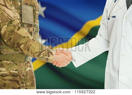 Military Man In Uniform And Doctor Shaking Hands With National Flag On Background - Solomon Islands