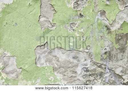 Old and worn out wall background with paint peeling off
