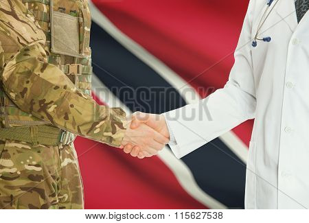 Military Man In Uniform And Doctor Shaking Hands With National Flag On Background - Trinidad And Tob