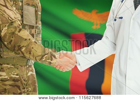 Military Man In Uniform And Doctor Shaking Hands With National Flag On Background - Zambia