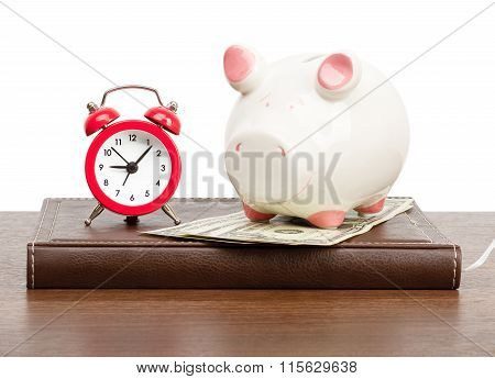 Alarm clock with piggy bank