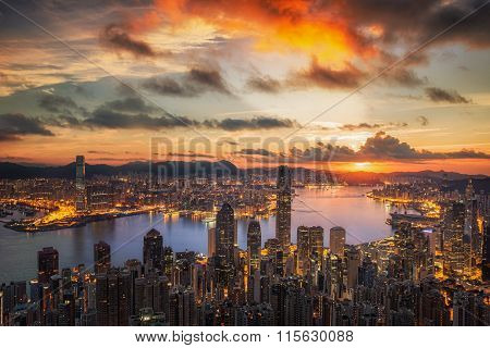 Sunrise over Victoria Harbor as viewed atop Victoria Peak with Hong kong and Kowloon below