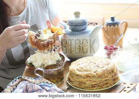 Female Hands Fill A Pancake With Cottage Cheese