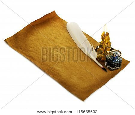 White Feather, Inkwell, Burning Candle On An Old Brown Paper Sheet Close-up Isolated. Retro Style.
