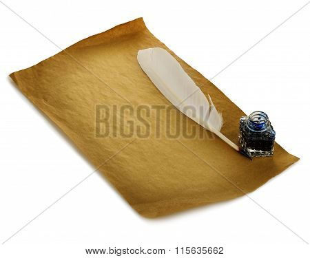 White Feather, Inkwell On An Old Brown Paper Sheet Close-up Isolated. Retro Style.