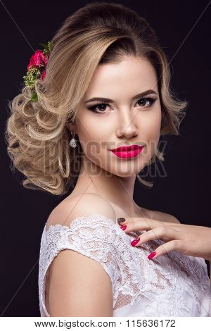 beautiful blond girl  in image of the bride with purple flowers on her head. Beauty face.