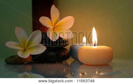 Plumeria flowers and candles