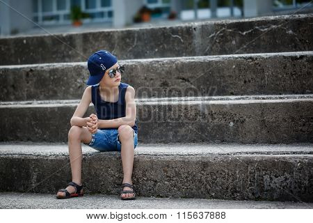 Fashionable Little Boy In Sunglasses And Cap. Childhood.  Summer