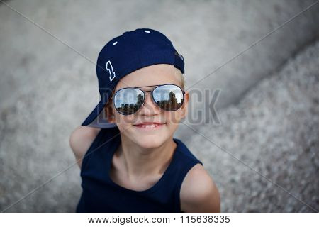 Portrait Of Fashionable Little Boy In Sunglasses And Cap. Childh