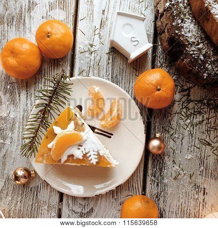 Orange Cake On The Wooden Background