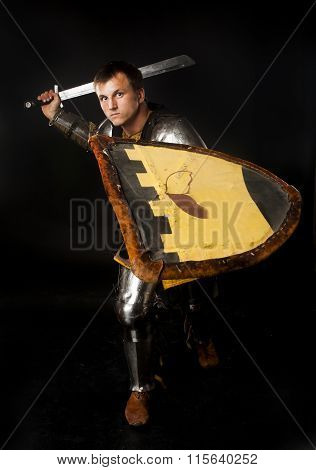 Medieval knight swinging his sword