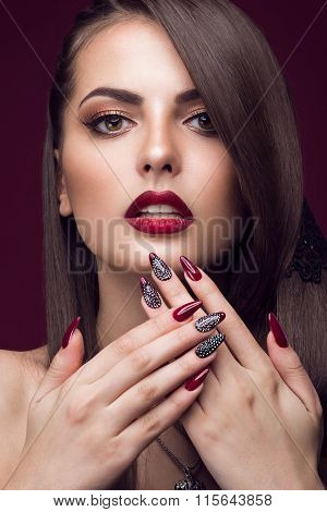 Pretty girl with unusual hairstyle, bright makeup, red lips and manicure design. Beauty face. Art na
