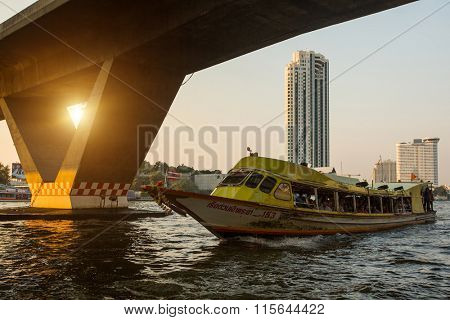 BANGKOK, THAILAND - JAN 23, 2016: Local transport boat on Chao Phraya river. More than 15 boat-lines operate on the rivers and canals of the city, including commuter lines, fares: by 8 to 40 Baht.