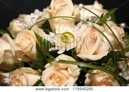 Wedding Rings Lie On A Bouquet Of The Bride