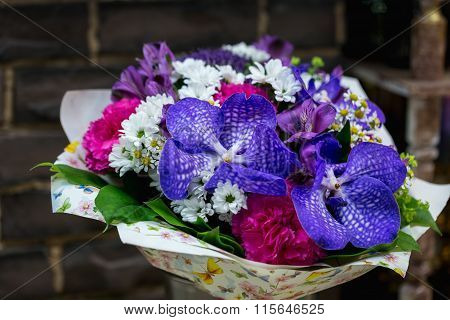 Flowers bouquet with carnation and blue orchids