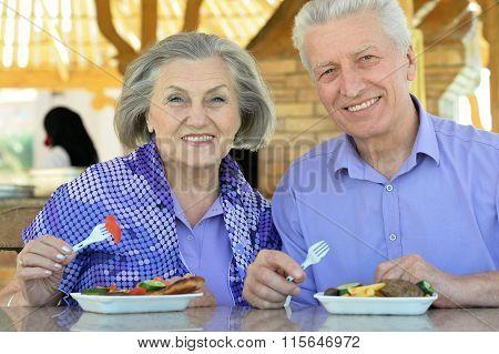 Senior couple having lunch