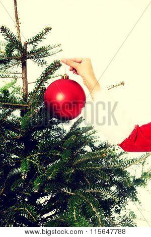 Santa woman decorating christmas tree