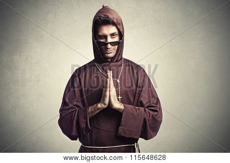friar with sunglasses