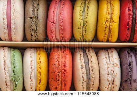 Stack Of Colorful Macaroons Stacked Up In The Box For Background
