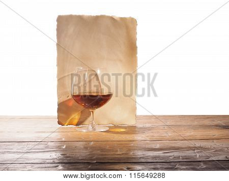 Glass Of Brandy, Old Paper Isolated On A White Background