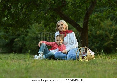 senior woman with little girl  in park