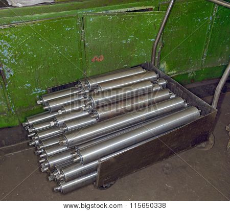 Stack Of Metal Shafts Is On Stock Platform Truck.