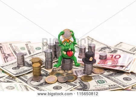 Leprechaun On The Pile Of Money With Euro Coin