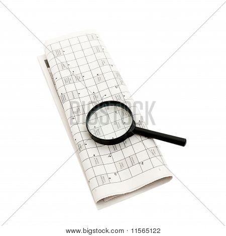 Magnifying glass over a newspaper