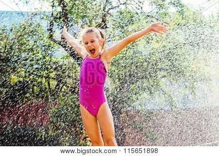 Little Girl Shouting Under Water Sprayer.