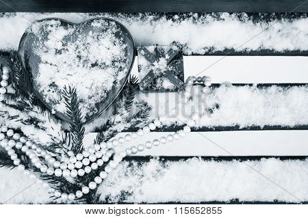 A Gift Box, Red Heart Shaped Tin Box With A White Pearl Necklace And A Fragment Of A Pine-tree Branc