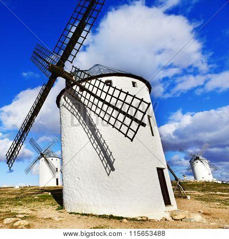 a traditional white windmill in Campo de Criptana, Spain