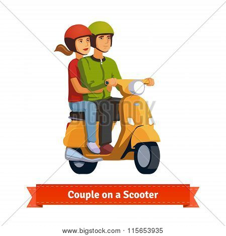 Couple on a scooter. Happy riding together