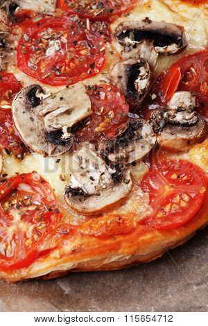 Puff pastry funghi pizza with mushrooms, tomato and cheese