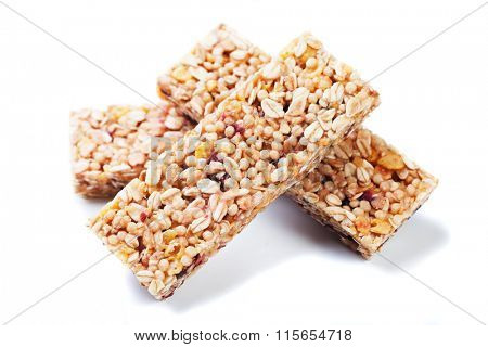 Granola bars with cereals and dried fruit isolated on white background