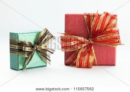Green And Red Gift Boxes With A Ribbon And Bow.
