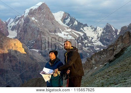 Climbers learning future route of ascent