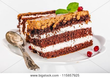 Chocolate Cake Stuffed With Whipped Cream Isolated On White Background