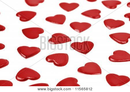 Red Hearts Confetti On White Background
