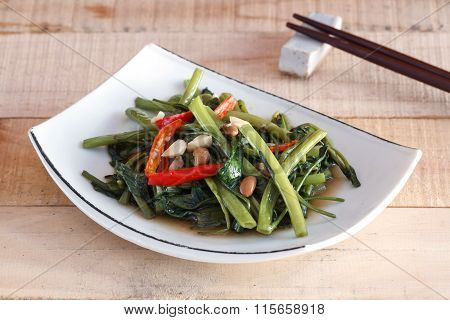 Thai Food Stir Fried Water Spinachon White Plate