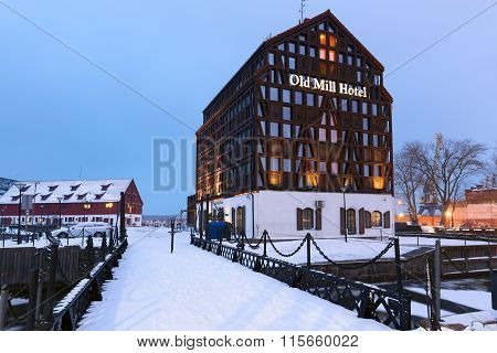 Snow-covered Old Mill hotel in the winter time.