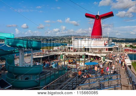 Carnival Conquest large cruise ship was docked at the coast of Jamaica