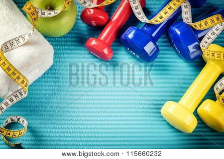 Fitness Frame With Dumbbells, Measuring Tape And Towel. Healthy Lifestyle Concept
