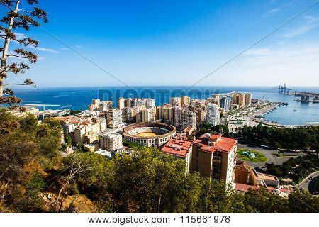 Malaga bullring, port and cityscape